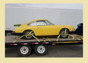 Yellow car on a trailer.