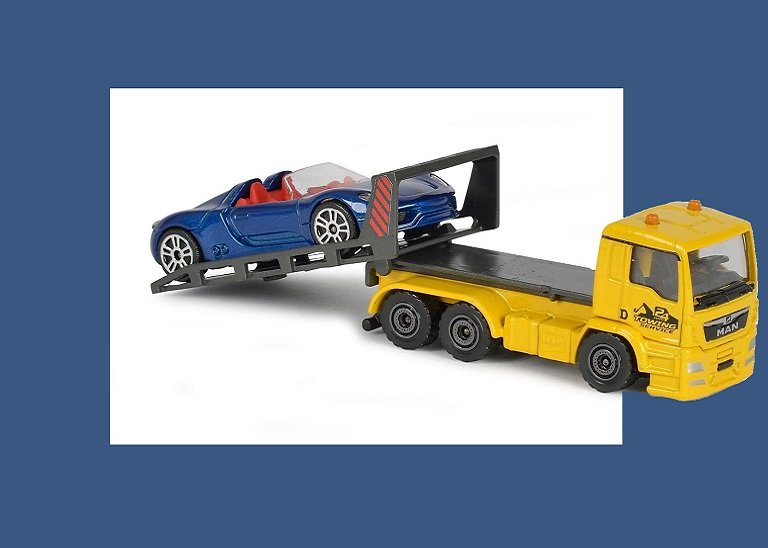Toy blue car being towed by a truck