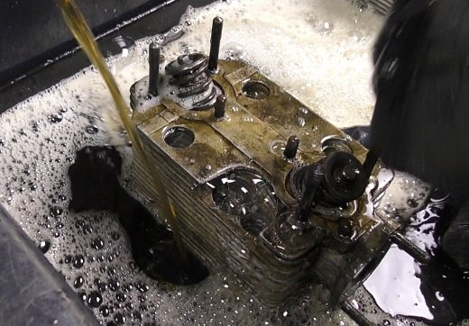a 911 Cylinder head in the wash bay