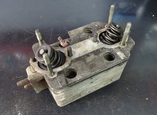 A 911 Cylinder head sitting on the bench. Ready for a rebuild