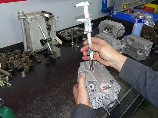 Using a set of vernia to measure installed height of the intake and exhaust valves.