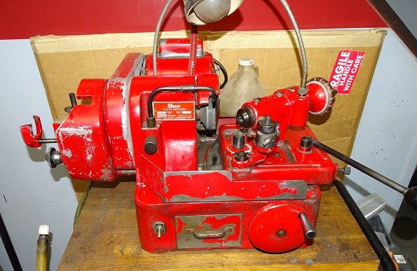 Valve grinding machine on a bench. This one is well used