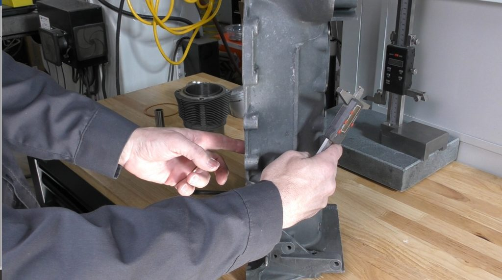 Measure the cranckcase before it is together but after the machine work.