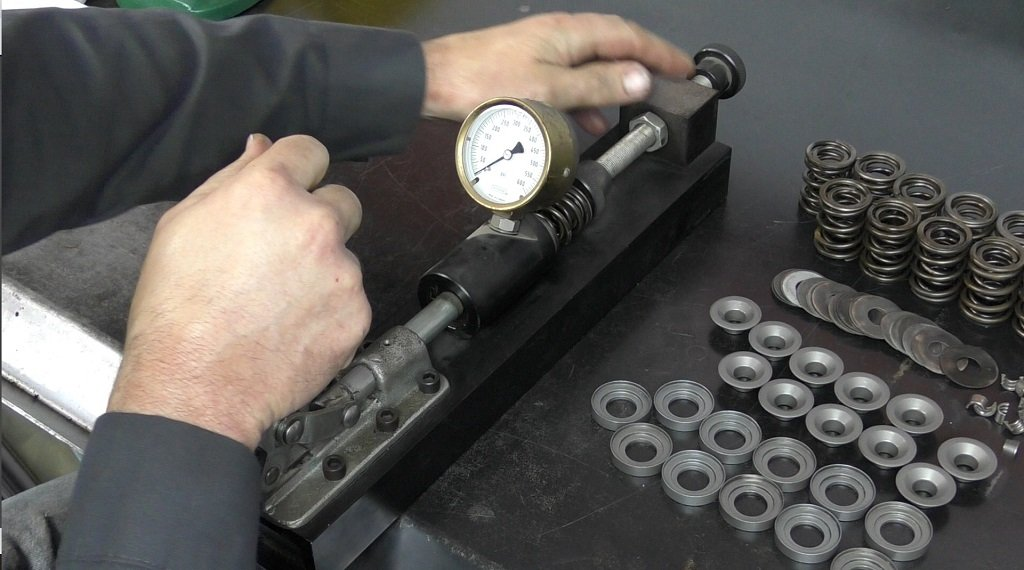 Using a sping tester on the valve springs