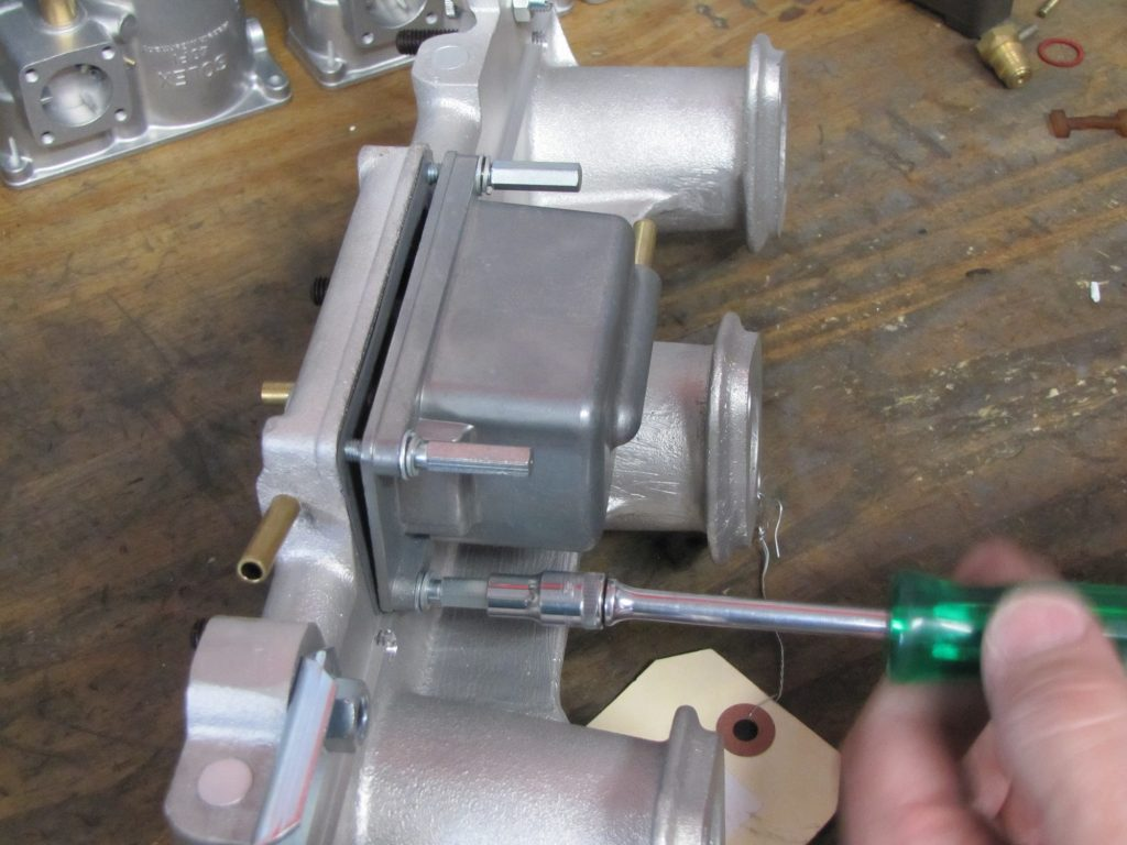 Attaching the cleaned manifold to the float bowl