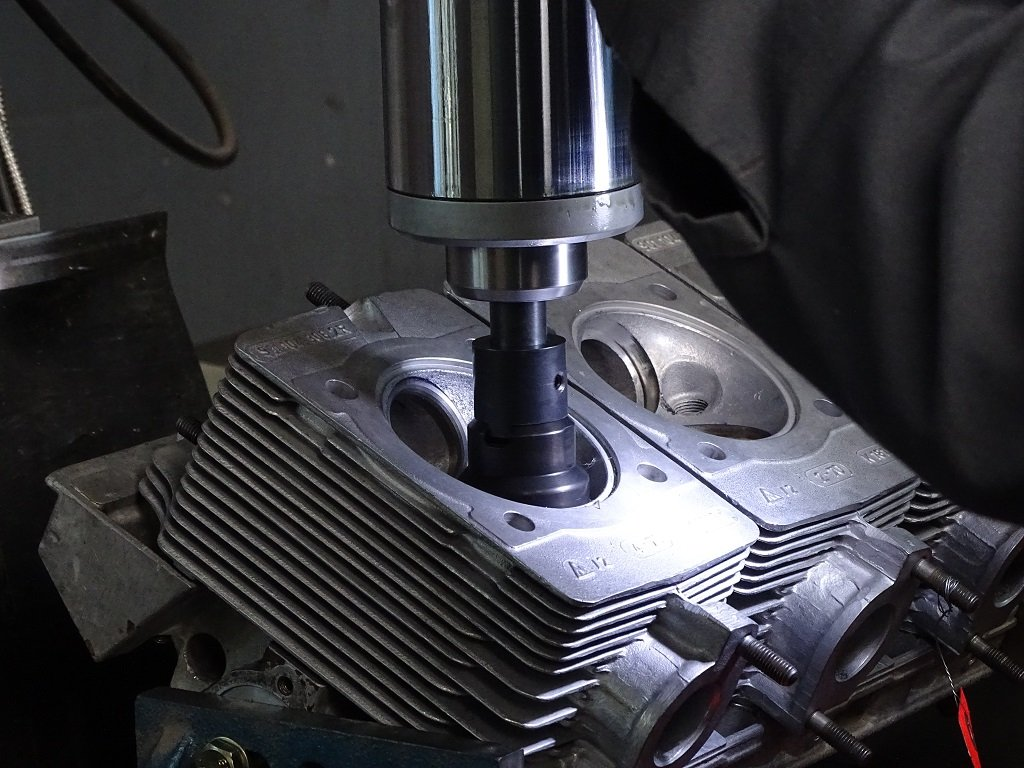 Counter bore tool cutting the seat pocket to replace valve seats