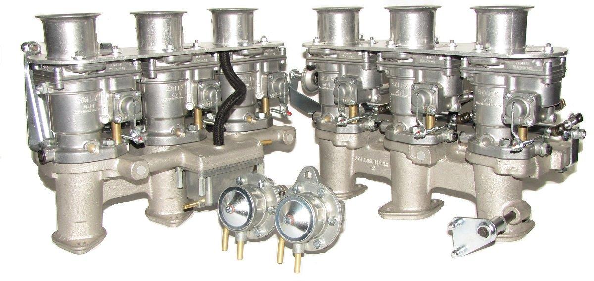 A restored set of Solex Carburetors with manifolds and circulation pump Solex 40P-I