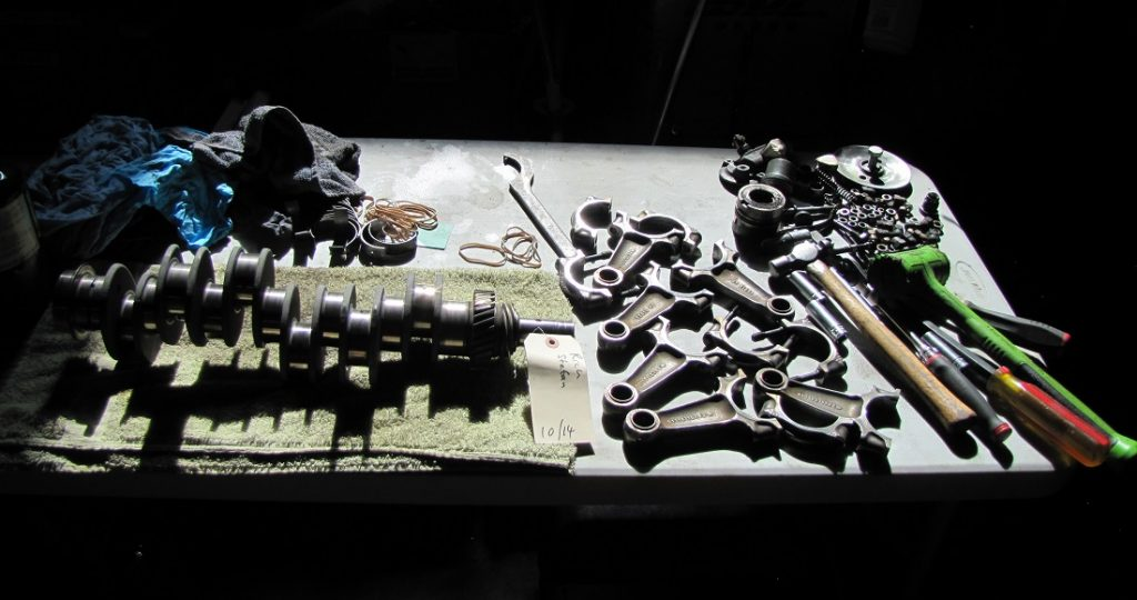 Inspecting the Con-rods and Crankshaft during disassembly