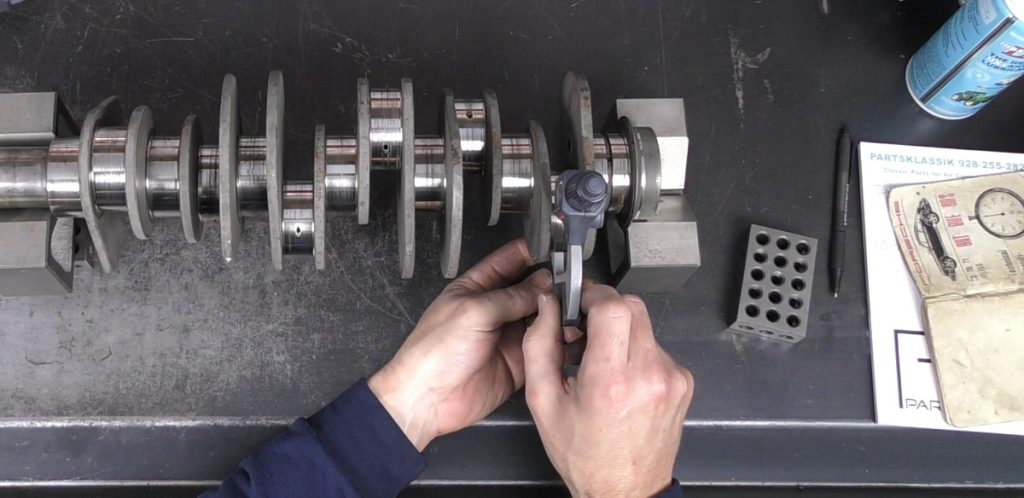 Measuring a crankshaft with a micrometer