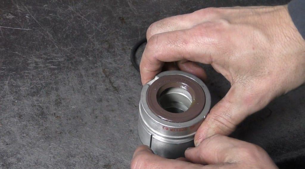 Nose bearing with front crankshaft seal