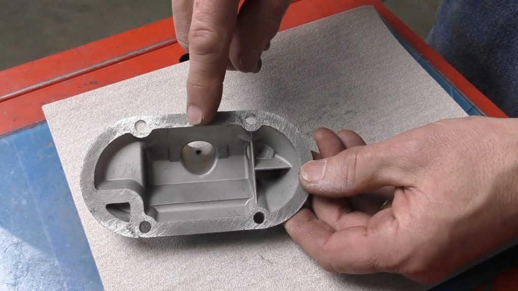 Sanding the oil breather plate