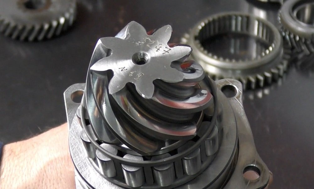 Drive gear showing the deviation number for this transaxle.